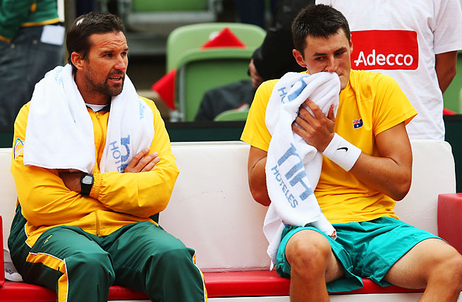 Australian Davis Cup captain Pat Rafter (left) sits with Bernard Tomic in a 2012 world group playoff.