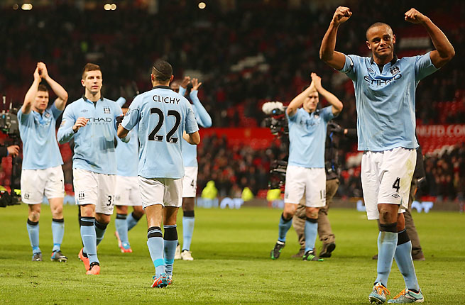 Vincent Kompany and Manchester City wrapped up a Champions League spot on Tuesday.
