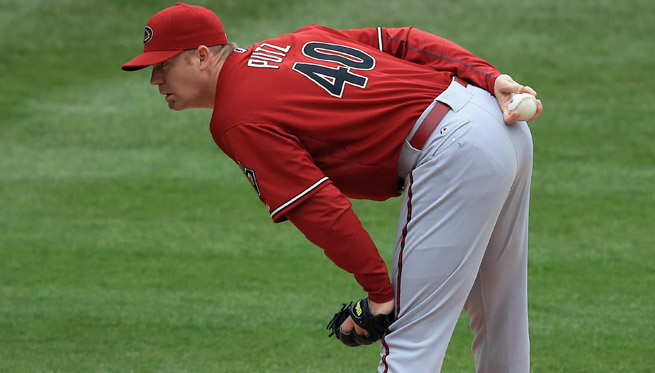 A right elbow strain will cost the Diamondbacks the services of closer J.J. Putz indefinitely.