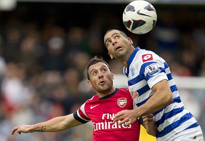 Tal Ben Haim battles with Santi Cazorla in a Premier League match.