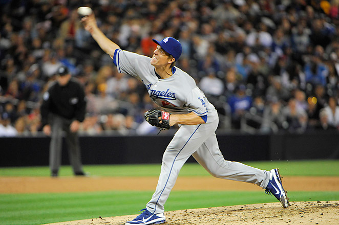 Greinke injured his left collarbone when Carlos Quentin charged the mound after Greinke hit him with a pitch.
