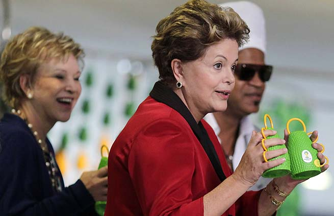 Brazil president Dilma Rousseff holds the Caxirola, musical instrument to be used at the 2014 Brazil World Cup.