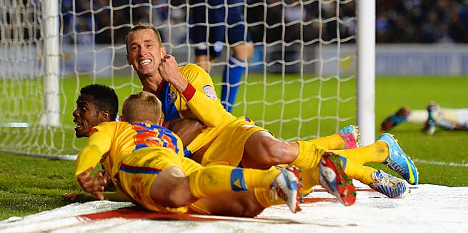 Crystal Palace celebrates Wilfried Zaha's first goal on Monday.