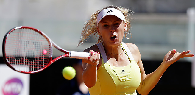 Caroline Wozniacki was stunned in the first round of the Italian Open, furthering her struggles on clay.