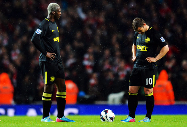 Shaun Maloney (right) looks down in dejection after falling behind to Arsenal in the second half.