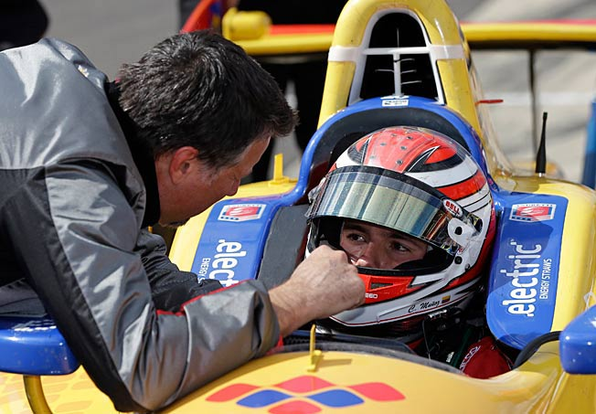Michael Andretti chats with Carlos Munoz, who passed his rookie test last Saturday.