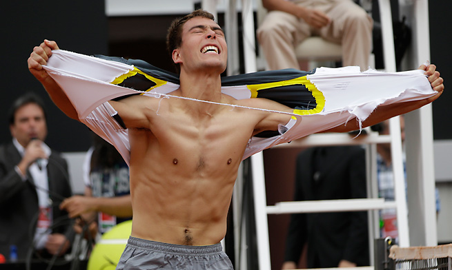 Poland's Jerzy Janowicz emphatically celebrates his upset win over Jo-Wilfred Tsonga on Wednesday.