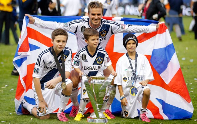 David Beckham celebrates the Galaxy's 2012 MLS Cup victory with his three sons.