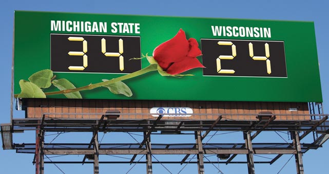 Upset Spartan-backers were responsible for this billboard after their favorite team failed to get a Rose Bowl-bid despite having defeated Pasadena-bound Wisconsin 34-24 in conference play and having tied the Badgers for the Big Ten Championship.
