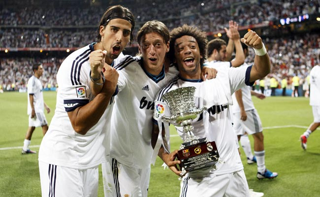 Real Madrid's Sami Khedira (left) and Mesut Oezil (middle) will both miss Germany's upcoming tour.