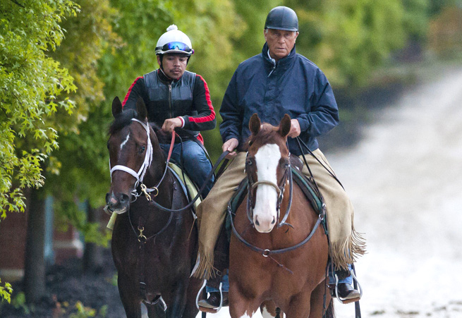 D. Wayne Lukas walks back from the track on Titletown Five after the horse's morning workout.