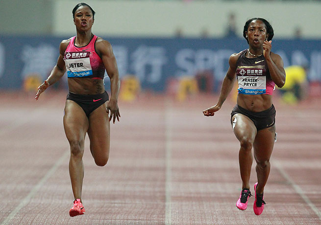 Shelly-Ann Fraser-Pryce (right) defeated Carmelita Jeter, who finished with an apparent injury, in the 100 meters.