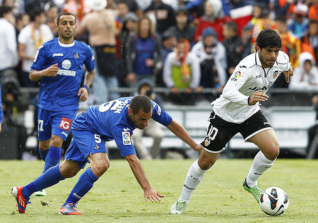 Valencia's Ever Banega breaks away during his side's win over Getafe.