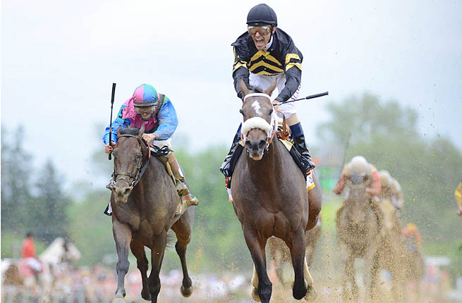 Oxbow (right) took the 138th Preakness Stakes, spoiling Orb's chances at a potential Triple Crown.