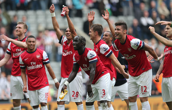 Arsenal players celebrate a win sealed on Laurent Koscielny's 52nd-minute volley.