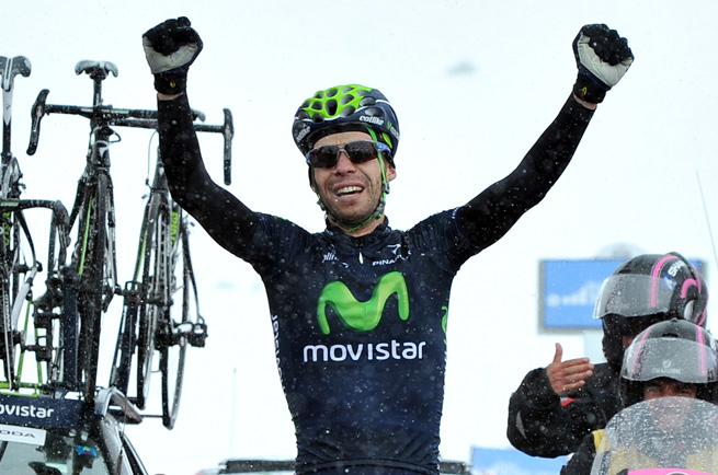 Italy's Giovanni Visconti celebrates after winning stage 15 with a solo ride up the Col du Galibier in inclement weather.