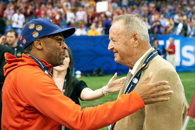 Spike Lee greets Bobby Bowden on the field before the BCS National Championship game between Alabama and LSU at Mercedes-Benz Superdome in New Orleans.