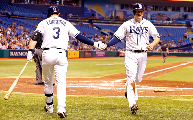 Kelly Johnson, receiving a high five from Evan Longoria, has put up strong stats for two weeks now.