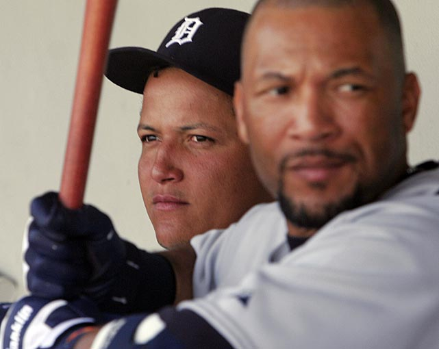 Cabrera sits in the dugout while outfielder Gary Sheffield practices his swing during a 2008 spring training game against Cleveland.