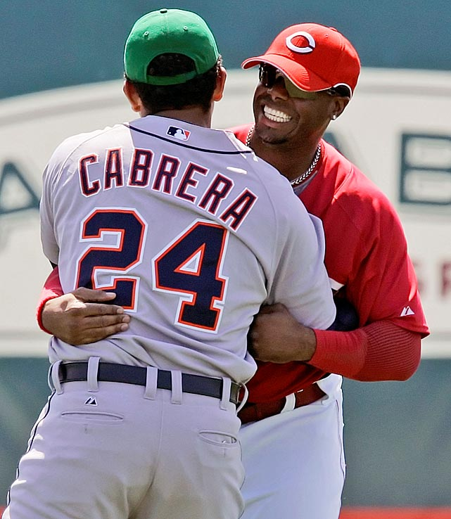 Ken Griffey Jr. greets Cabrera in center field during warm ups for spring training baseball action in Sarasota.