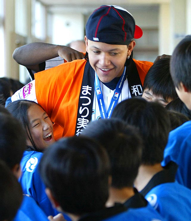 Cabrera gets an enthusiastic welcome from students during a visit to Wajiro Higashi Elementary in Fukuoka, western Japan.