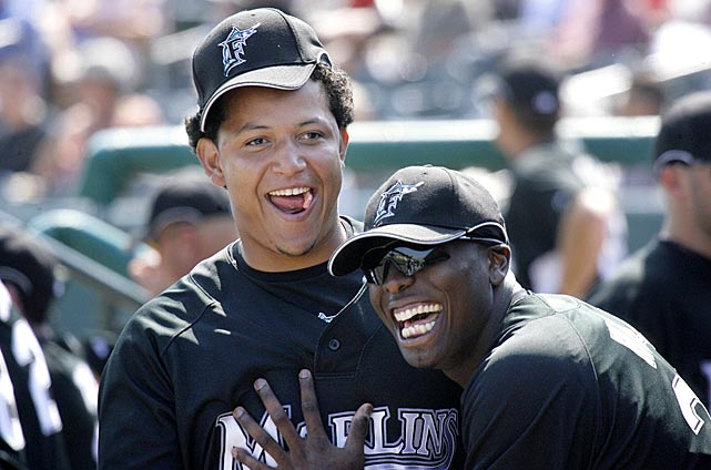 Cabrera and pitcher Dontrelle Willis joke in the dugout during a spring training game against St. Louis. The duo was traded to Detroit in December 2007.