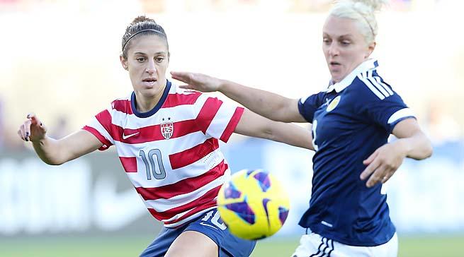 U.S. midfielder Carli Lloyd battles a Scottish player during a February friendly.