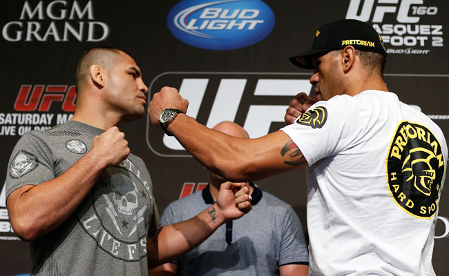 Cain Velasquez (left) threw Antonio Silva onto his back within the first five seconds of their last bout.