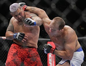 "Cain Velasquez (12-1) made the first successful defense of his UFC heavyweight title, stopping Antonio ""Bigfoot"" Silva in just 1:21."