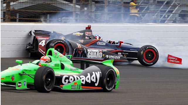 James Hinchcliffe of Canada, bottom, goes under as JR Hildebrand hits the wall in the first turn.