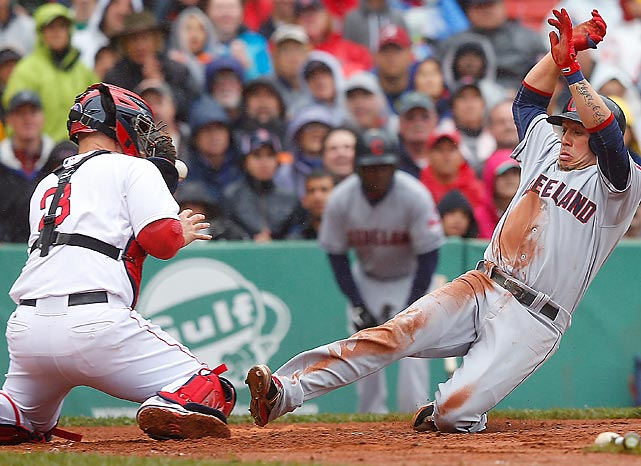 Red Sox catcher David Ross prepares to tag out the Indians' Asdrubal Cabrera during the third inning of a game at Fenway Park.