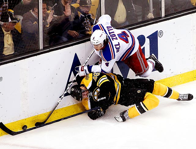 The Bruins' David Krejci and the Rangers' Michael Del Zotto battle for the puck during Game 5 of the Eastern Conference Semifinals. The Bruins won the fifth game to advance to the conference finals.
