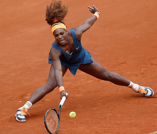 Serena Williams returns a shot against Anna Tatishvili during their first-round match of the French Open.