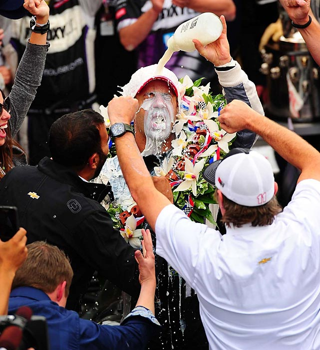 Tony Kanaan celebrates with the winner's milk (this year, it was 2-percent milk) after winning his first Indianapolis 500.