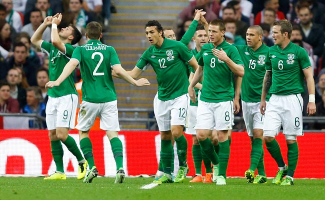 Shane Long (left) celebrates after giving Ireland a 1-0 lead over England in the 13th minute.