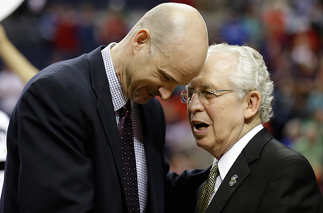 SEC commissioner Mike Slive (right), seen with Ole Miss coach Andy Kennedy, wants better basketball.