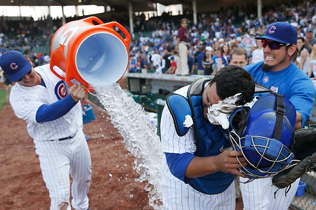 A trio of Chicago Cubs stage a dignified celebration after defeating the crosstown rival White Sox, 9-3, at Wrigley Field. Navarro hit three home runs in the game as was thus treated to a drink and dessert.