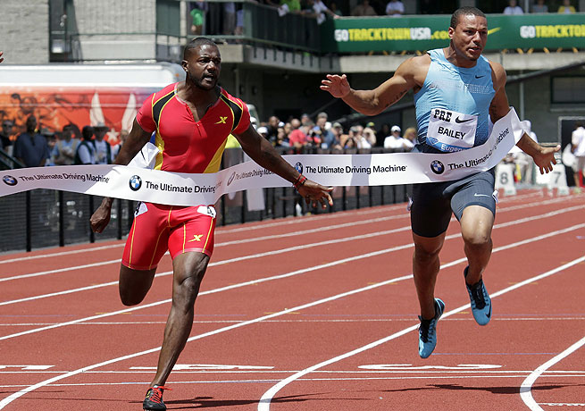 Justin Gatlin (left) took the 100-meter race at the Prefontaine Classic in a wind-aided 9.88 seconds.