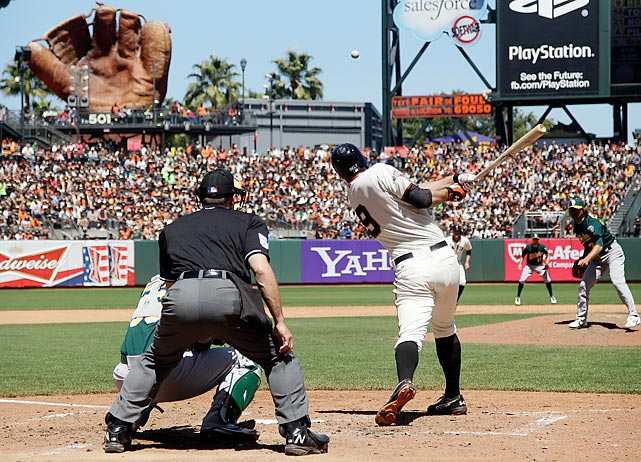 Brandon Belt watches the ball come off his bat for a two-run double off Oakland A's pitcher Hideki Okajima in the sixth inning of a 5-2 win for the Giants on May 30.