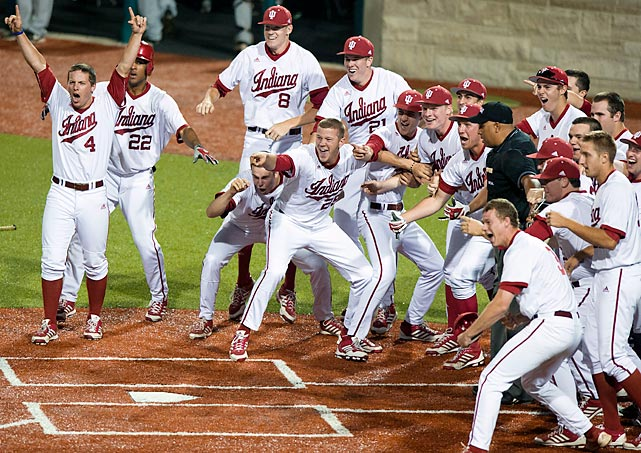 Indiana players celebrate and wait for Chad Clark after his game-winning home run in the ninth inning powered a 5-4 win against Valparaiso on May 31 in an NCAA Regionals game.
