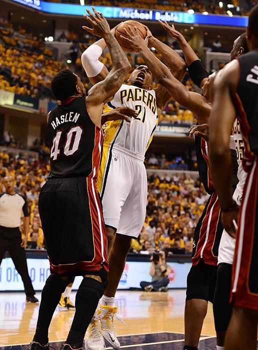 Pacers forward David West cuts through a forest of arms to get to the basket in Indiana's 99-92 Game 4 win over the Miami Heat to stay in the fight for the conference title.