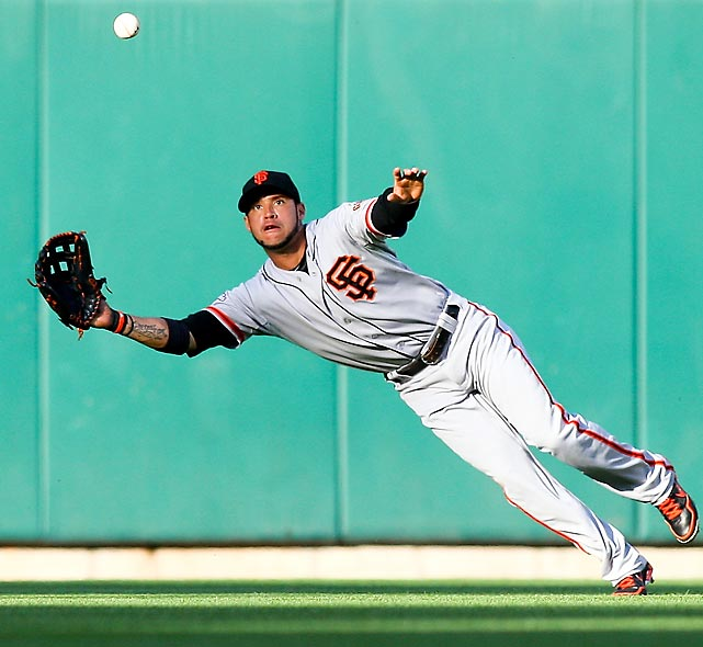 Giants leftfielder Gregor Blanco dives for the out during a June 2 double-header against St. Louis, both of which the Cardinals won by a score of 15-1.