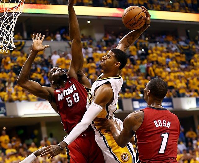 Paul George asserts his dominance against Joel Anthony and Chris Bosh with this dunk in the Pacers' Game 6 win over the Heat on June 1.