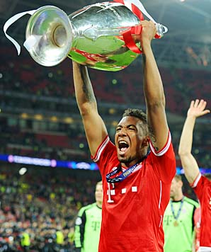 The author, with Jerome Boateng's Champions League medal.