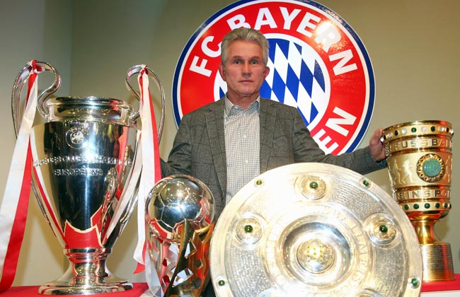 Jupp Heynckes poses with the four trophies Bayern Munich won this season.