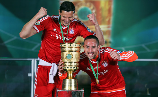 Daniel van Buyten (left) and Franck Ribery pose after winning the DFB Cup in June.