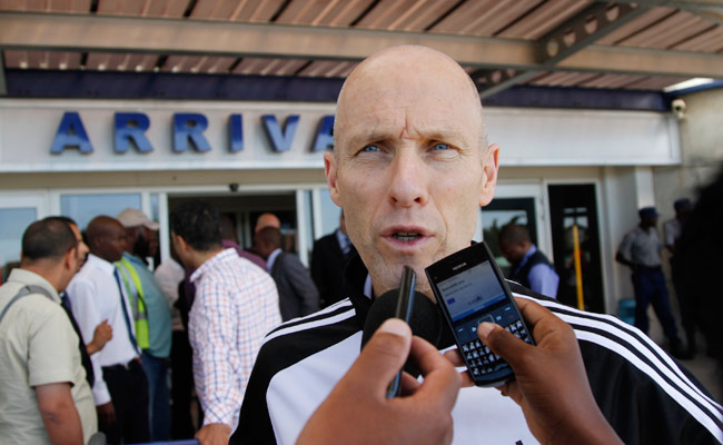 Bob Bradley talks to the media upon arriving in Zimbabwe on Thursday for a World Cup qualifier.