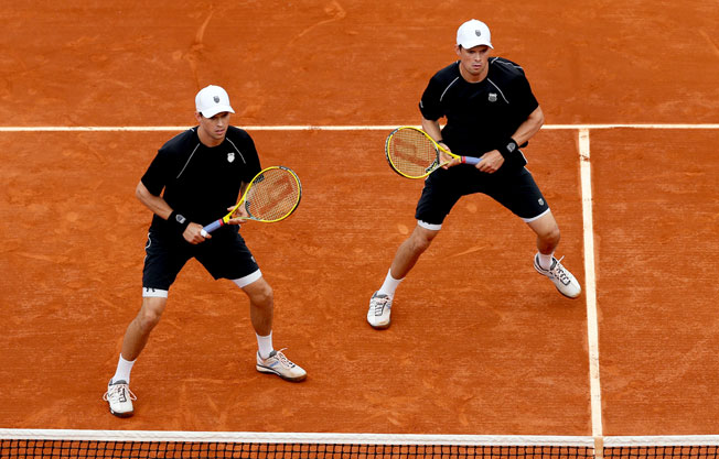 Mike (left) and Bob Bryan advanced to the doubles finals by beating Alexander Peya and Bruno Soares.