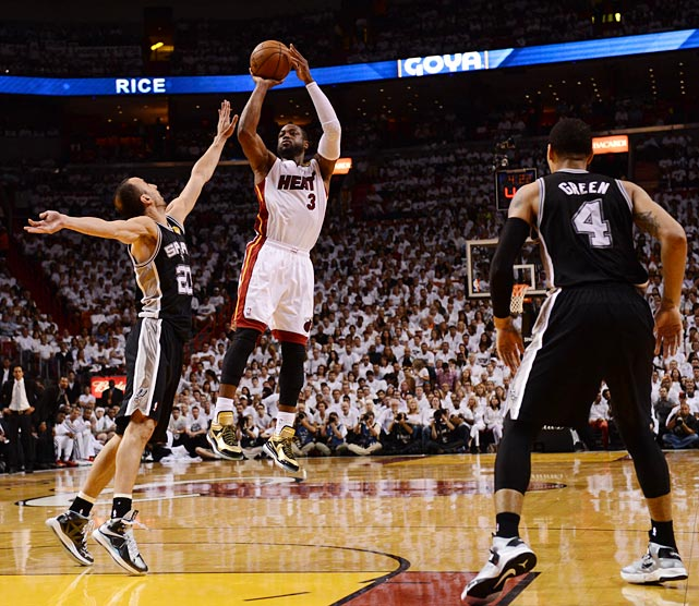 Dwayne Wade burned Manu Ginobili and the Spurs for 17 points in the first three quarters, but was held scoreless in the fourth.