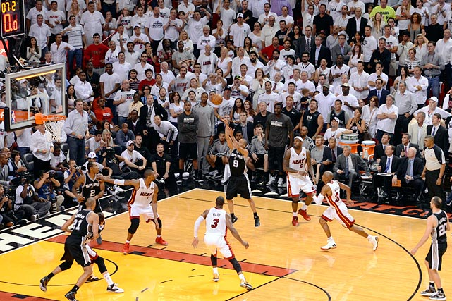 SI's best shots from Game 1 of the 2013 NBA Finals, beginning with Tony Parker's game-sealing jumper right before the shot clock expired. The basket gave San Antonio a four-point lead with five seconds to go.